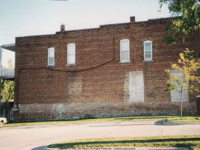 Photo of bare brick wall as it started out.