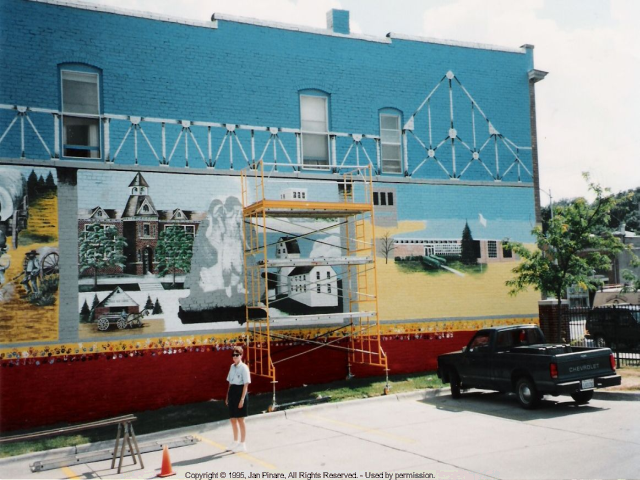 Photo of the right side of the mural showing a participant standing on the ground.