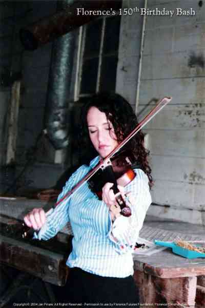 Natalie Harward plays fiddle at the Florence Mill.