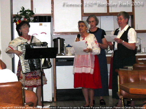 Czech women playing and singing at Notre Dame Convent; here, we heard the history of Notre Dame, and were also able to buy fresh-baked Kolaches ... until they sold out! Left to right: Sr Stephanie Matcha ND (playing accordion), Sr Christine Elias ND (wearing Czech outfit), Sr Mary Ann Zimmer ND (taller in back), Sr Celeste Wobeter ND (with black vest).